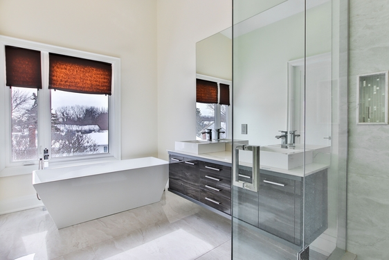 Bathroom renovation we completed with large frameless mirror and frameless shower panel