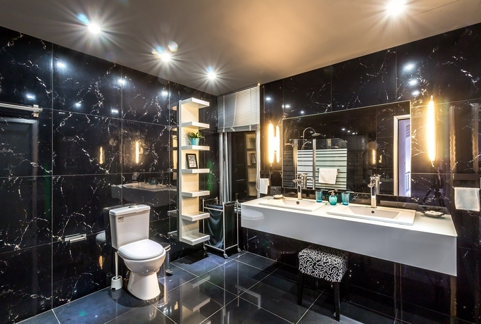 Bathroom wall and floor tiling job done with black marble finish wall tiles (1)