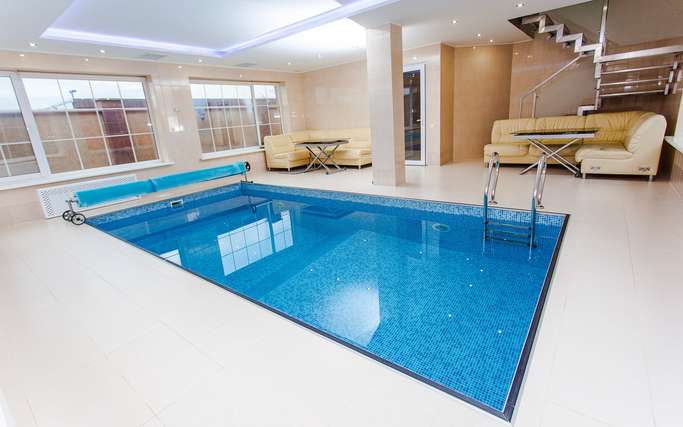 Luxury indoor pool tiling job we completed with pool surround tiles